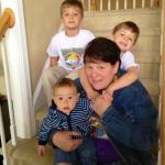 diane sitting on steps with three kids