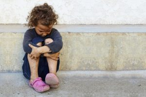a young girl sitting alone