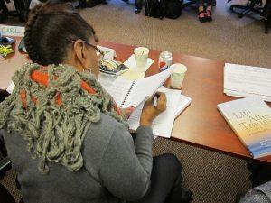 IFP CLass participant reading