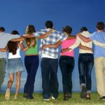a group of youth linking arms