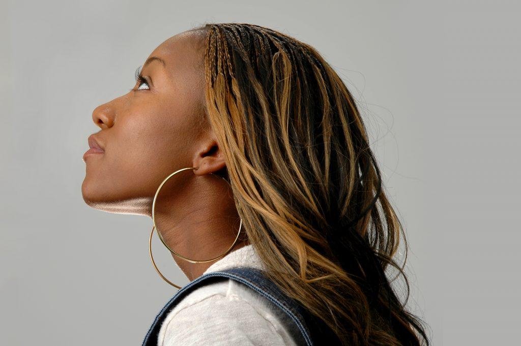 Profile of young African American over a neutral background.