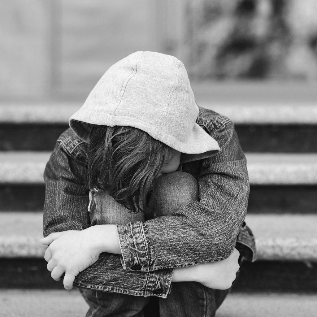 Kid having sad feeling.