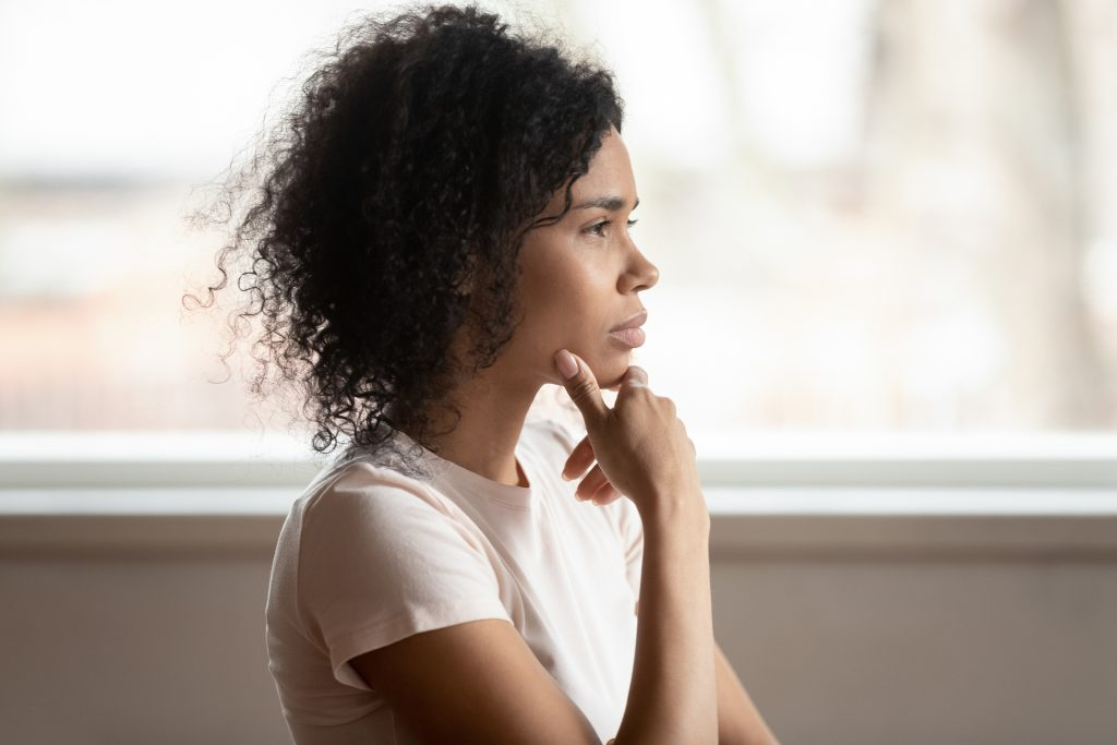 Pensive mixed race woman thinking makes decision, side view