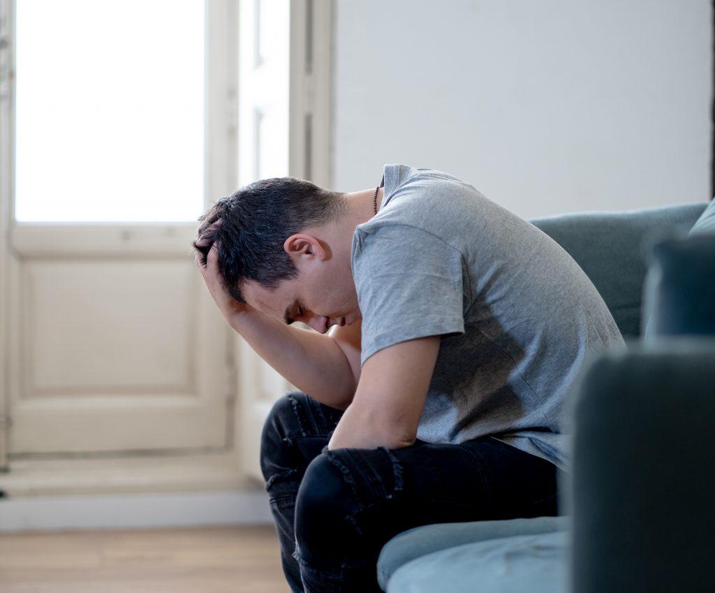 Sad depressed young man devastated feeling hurt suffering Depression Loneliness