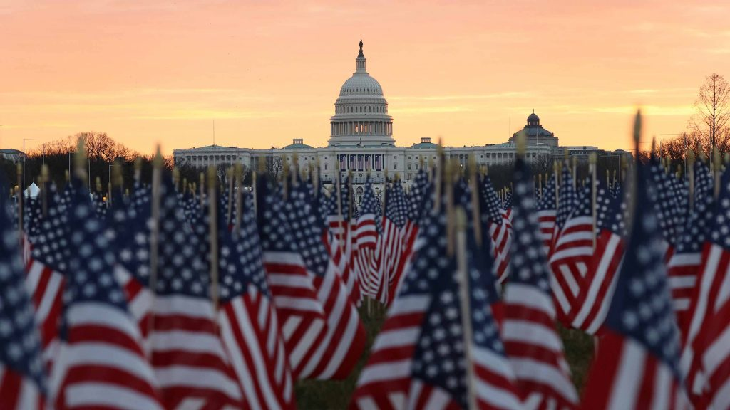 The U.S Capitol Building is prepared for the inaugural ceremonies for President-elect Joe Biden as American flags are placed in the ground on the National Mall on January 18, 2021 in Washington, DC.