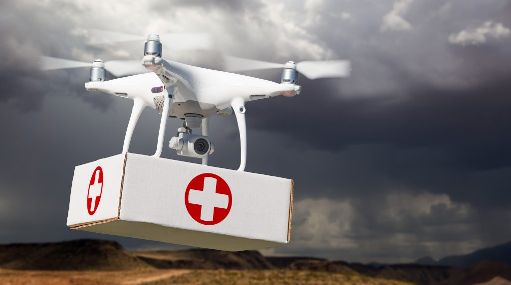 Unmanned Aircraft System (UAV) Drone Carrying Vaccine/First Aid