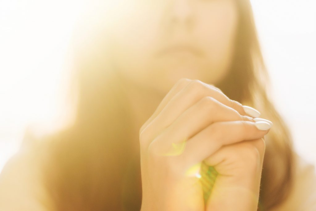 Woman hands praying, begging for forgiveness and believe in goodness.