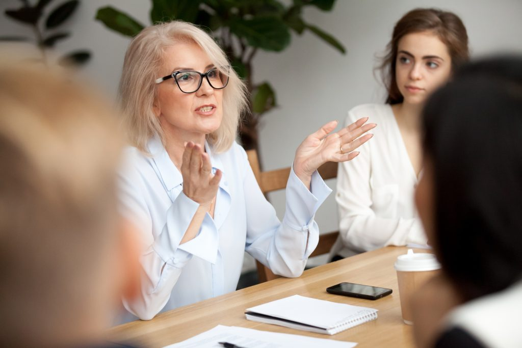 businesswoman, teacher or mentor coach speaking to people, female business leader speaker talking at meeting