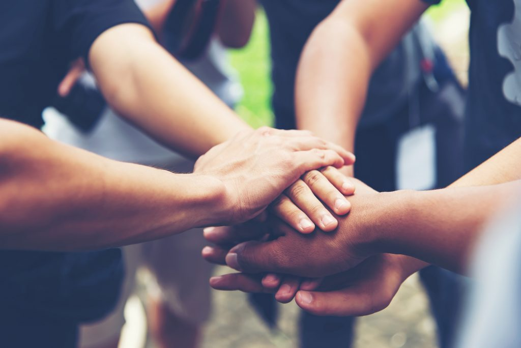 Hands of people working together, unity