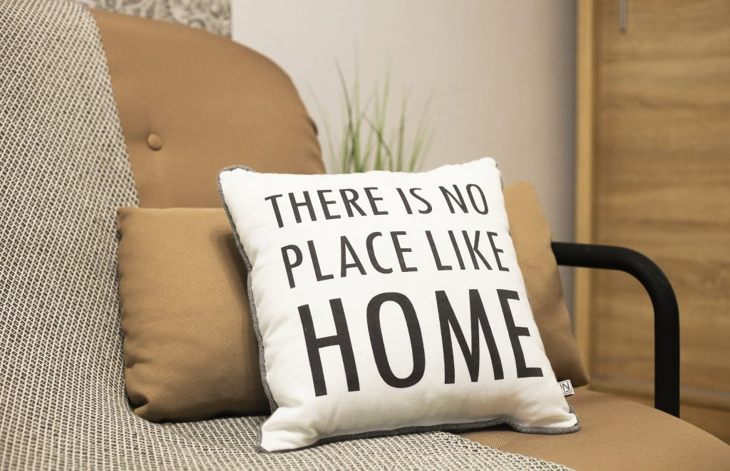 Cushions with a text There is no place like home. Stay home, work from home coronavirus prevention concept, quarantine