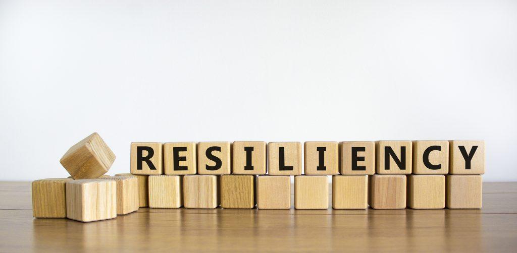 Word 'Resiliency' written on wooden blocks.