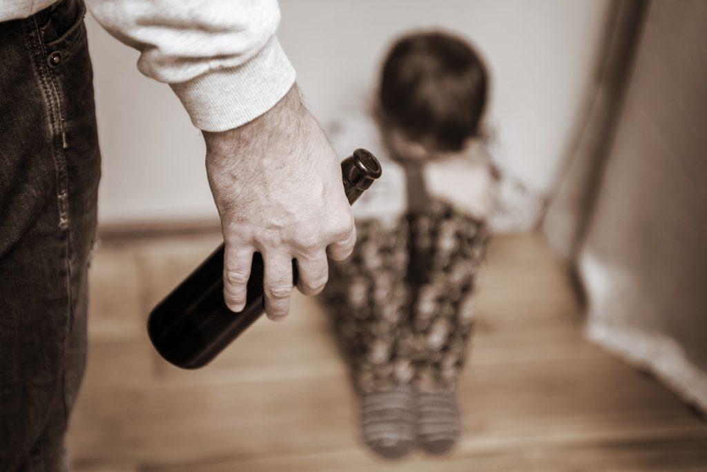 Drunk parent and little scared son. Violence against children concept. Aggression in the family. Alcohol abuse. Domestic violence